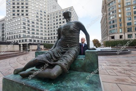 John Biggs, Mayor of Tower Hamlets, with 'Draped Seated Woman', 1957, sculpture by Henry Moore in Cabot Square, Canary Wharf