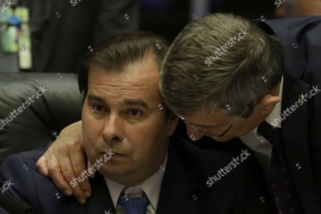 Rodrigo Maia, Darcisio Perondi. Brazil's President of the Chamber of Deputies Rodrigo Maia, left, is embraced by Deputy Darcisio Perondi during a congressional hearing before the key vote by the lower house on whether to suspend President Michel Temer and put him on trial over an alleged bribery scheme, in Brasilia, Brazil, . This is the second time Temer faces such a vote and is one more in a litany of scandals that have dogged his presidency since he replaced President Dilma Rousseff, who was impeached and removed from office last year