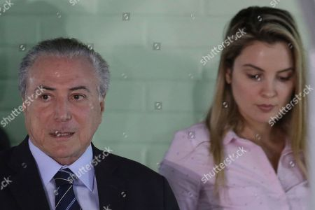 Michel Temer, Marcela Temer. Brazil's President Michel Temer accompanied by his wife Marcela, leaves the Military Hospital, in Brasilia, Brazil, . Temer was hospitalized on Wednesday with an urinary obstruction, his office said, even as lawmakers debated in Congress whether to suspend him and put him on trial on corruption charges