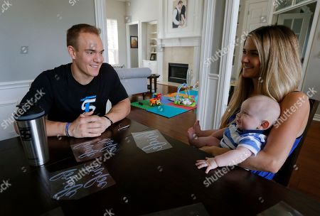 Stock Picture of Chris Gronkowski, Brittany Gronkowski, Bear James Gronkowski. Former NFL fullback and creator of the Ice Shaker water bottle and shaker cup, Chris Gronkowski, sits with his wife, Brittany, and son, Bear, as the two pause from working at their home, in Colleyville, Texas. For business advice, Gronkowski turned to his father, who'd had his own company for 26 years. He helped shore up Gronkowski's confidence and also gave him some realistic advice