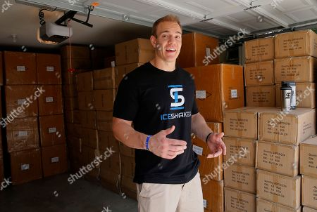 Former NFL fullback Chris Gronkowski poses with boxes of his product, as he talks about the Ice Shaker, stacked in his garage, in Colleyville, Texas. For business advice, Gronkowski turned to his father, who'd had his own company for 26 years. He helped shore up Gronkowski's confidence and also gave him some realistic advice
