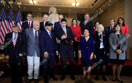 Paul Ryan, Celestino Almeda, Frank Francone, Aquilino Delen, Alicia Benitez, Margrit Baltazar, Caroline Burkhart, David Shulkin, Mitch McConnell, Chuck Schumer, Nancy Pelosi, Dean Heller, Mazie Hirono, Ed Royce, Tulsi Gabbard. Speaker of the House Paul Ryan of Wis., presents the Congressional Gold Medal to Filipino veterans of World War II and their next of kin, from left, Celestino Almeda, Frank Francone, Aquilino Delen, Ryan, Alicia Benitez, Margrit Baltazar and Caroline Burkhart, during a ceremony at the Emancipation Hall on Capitol Hill in Washington, . Standing with the recipients are, from left back row, Veterans Affairs Secretary David Shulkin, Senate Majority Leader Mitch McConnell of Ky., Senate Minority Leader Chuck Schumer of New York, House Minority Leader Nancy Pelosi of Calif., Senator Dean Heller, R-Nev., Senator Mazie Hirono, D-Hawaii, Rep. Ed Royce, R-Calif., and Rep. Tulsi Gabbard, D-Hawaii