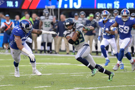 Keenan Robinson, Doug Baldwin. New York Giants linebacker Keenan Robinson, left, attempts to tackle Seattle Seahawks wide receiver Doug Baldwin (89) during the first half of an NFL football game, in East Rutherford, N.J