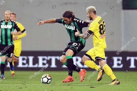 Sassuolo's Alessandro Matri (L) and Udinese's Valon Behrami (R) in action during the Italian Serie A soccer match US Sassuolo vs Udinese Calcio at Mapei Stadium in Reggio Emilia, Italy, 25 October 2017.