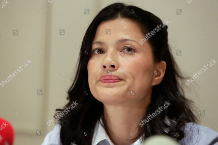 Actress Natassia Malthe reacts during a news conference in New York, where she alleged sexual assault by producer Harvey Weinstein in 2010