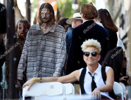 """Zombie characters arrive at a posthumous star ceremony for the late director George A. Romero on the Hollywood Walk of Fame, in Los Angeles. Romero, the writer/director of the 1968 film """"Night of the Living Dead"""" among many others, died on July 16"""