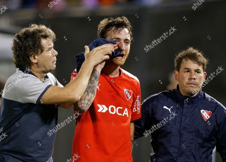 Argentina's Independiente Fernando Amorebieta leaves the pitch after being hit in the face during a Copa Sudamericana quarter final soccer game against Paraguay's Nacional, in Asuncion, Paraguay