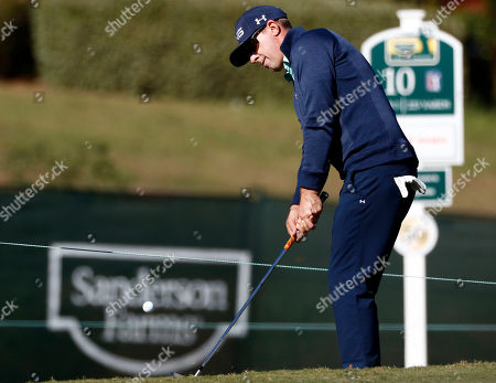 Hunter Mahan chips onto the putting surface on the 10th hole during the Pro-Am play at the Country Club of Jackson, Miss., the day before the first round of the Sanderson Farms Championship golf tournament. The event is the only regular PGA tour event in Mississippi