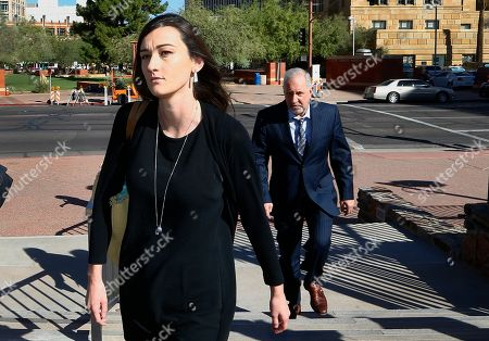 Laney Sweet, left, widow of Daniel Shaver, arrives at Maricopa County Superior Court with attorney Mark Geragos, right, for the opening statements in the trial of former Mesa, Ariz., police officer Philip Brailsford, charged with murder in the fatal 2016 shooting of the unarmed Shaver, in Phoenix