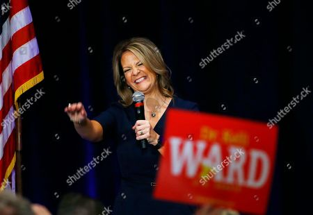 In a photo, former Republican Arizona state Senator Kelli Ward smiles as she is greeted by supporters at a campaign fundraiser, in Scottsdale, Ariz. Ward was expected to run against Republican U.S. Senator Jeff Flake in the Arizona 2018 primary, but Flake has bowed out of a re-election, announcing his retirement on Tuesday. Flake's decision to bow out of a re-election fight could spur a rush of other Republican candidates who hope to take on his only announced challenger in the Arizona primary next year