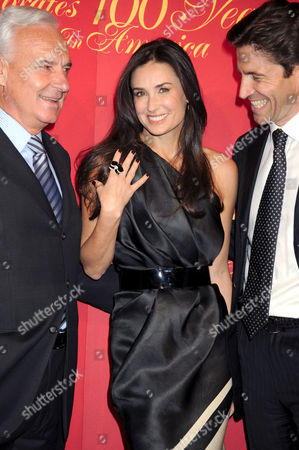 Demi Moore with President and CEO of Cartier International Bernard Fornas and President and CEO of Cartier North America Frederic de Narp