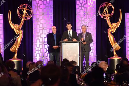 Mike Minkler, Colin McDowell, Gary Simpson. Mike Minkler, from left, Colin McDowell, and Gary Simpson accept the Engineering Emmy Award for McDSP SA-2 Dialog Processor at the 69th Engineering Emmy Awards, presented by the Television Academy at the Loews Hollywood Hotel on in Hollywood, Calif