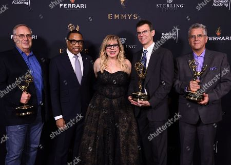 Stock Photo of Mike Minkler, Hayma Washington, Kirsten Vangsness, Colin McDowell, Gary Simpson. Mike Minkler, from left, Hayma Washington, Chairman and CEO of the Television Academy, Kirsten Vangsness, Colin McDowell, and Gary Simpson pose with the Engineering Emmy Award for McDSP SA-2 Dialog Processor at the 69th Engineering Emmy Awards, presented by the Television Academy at the Loews Hollywood Hotel on in Hollywood, Calif