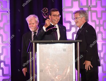 Larry Thorpe, Elliot Peck, Tim Smith. Larry Thorpe, from left, Elliot Peck, and Tim Smith accept the Engineering Emmy Award for Canon 4k Zoom Lenses at the 69th Engineering Emmy Awards, presented by the Television Academy at the Loews Hollywood Hotel on in Hollywood, Calif