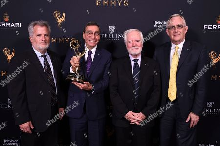 Tim Smith, Elliot Peck, Larry Thorpe, Scott Antaya. Tim Smith, from left, Elliot Peck, Larry Thorpe, and Scott Antaya pose with the Engineering Emmy Award for Canon 4k Zoom Lenses at the 69th Engineering Emmy Awards, presented by the Television Academy at the Loews Hollywood Hotel on in Hollywood, Calif