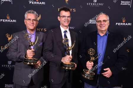 Gary Simpson, Colin McDowell, Mike Minkler. Gary Simpson, from left, Colin McDowell, and Mike Minkler pose with the Engineering Emmy Award for McDSP SA-2 Dialog Processor at the 69th Engineering Emmy Awards, presented by the Television Academy at the Loews Hollywood Hotel on in Hollywood, Calif