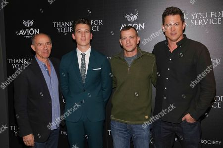 "Jon Kilik, Miles Teller, Adam Schumann, Jason Hall. Producer Jon Kilik, from left, actor Miles Teller, Army veteran Adam Schumann and director Jason Hall attend a special screening of ""Thank You for Your Service"" at The Landmark at 57 West, in New York"
