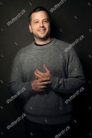 Aaron Guzikowski poses for a portrait at Quaker Good Energy Lodge with GenArt and the Collective, during the Sundance Film Festival, on in Park City, Utah