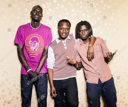 """Ger Duany, Arnold Oceng, and Emmanuel Jal pose for a portrait during press day for """"The Good Lie"""" at Le Montrose Hotel in Los Angeles. In the film, Jal portrays Paul, the quick-learning adult member of a surviving trio of adopted brothers who are relocated to Kansas City, separated from their sister who was dispatched to Boston. He's joined on screen by fellow former Sudanese refuge Duany and British actor Oceng, who plays the group's de-facto chief tasked with reuniting the family in America"""