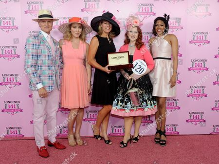 Stock Image of Jennifer Judkins, center, of Longines, along with Longines Ambassador of Elegance and World Cup Alpine skier Mikaela Shiffrin, second left, and celebrity judges Monte Durham, left, and Alicia Quarles, right, present Jody DeFord, of Indianapolis, with a Longines Conquest Classic after she won the Longines Kentucky Oaks Fashion Contest on Kentucky Oaks Day, in Louisville, Ky. Longines, the Swiss watch manufacturer known for its luxury timepieces, is the Official Watch and Timekeeper of the 141st annual Kentucky Derby