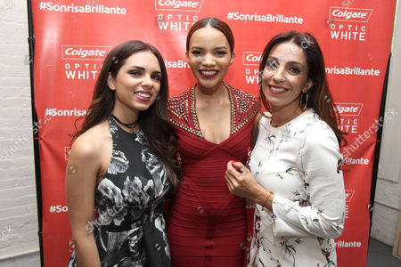 From left, Optic White Chicas Blogueras Daniela Ramirez, Artist Leslie Grace, and Optic White Chicas Blogueras Kika Rocha, are seen at the Colgate Optic White Bar de Belleza at Haven's Kitchen on Tue., in New York City