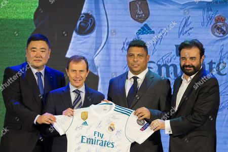 (L-R) Youwen Bu, Director of Real Madrid's office in China; Emilio Butragueno, Director of Institutional Relations of Real Madrid; Former Brazilian soccer player Ronaldo and Real Madrid's managing director Miguel Angel Sanchez pose for photographs during the Real Madrid China Summit event in Beijing, China, 26 October 2017. Real Madrid presented the commercial strategy in China and the organization of the Real Madrid Office in Beijing.