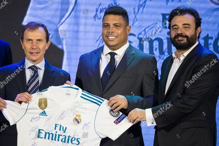 (L-R) Emilio Butragueno, Director of Institutional Relations of Real Madrid; Former Brazilian soccer player Ronaldo and Real Madrid's managing director Miguel Angel Sanchez pose for photographs during the Real Madrid China Summit event in Beijing, China, 26 October 2017. Real Madrid presented the commercial strategy in China and the organization of the Real Madrid Office in Beijing.