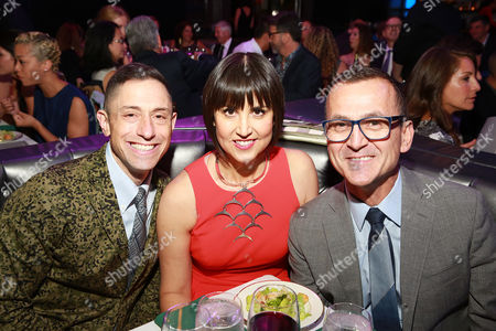 IMAGE DISTRIBUTED FOR BENJAMIN MOORE - Home furnishings designer Jonathan Adler, left, and Steven Kolb, CEO, CFDA, right, congratulate fashion designer Trina Turk at the 2014 Benjamin Moore HUE Awards on at the Highline Ballroom in New York