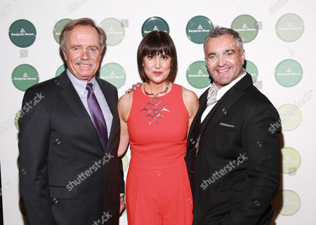 From left, Benjamin Moore CEO Michael Searles, fashion designer Trina Turk and interior designer Martyn Lawrence Bullard pose together at the sixth annual Benjamin Moore HUE Awards on at the Highline Ballroom in New York