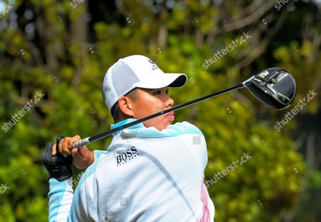 Guan Tianlang (China) tees off from the 14th on day one
