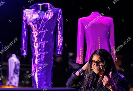 Musician Prince's sister Tyka Nelson poses for photographers in front of 'Purple Rain' costumes at the 'My Name is Prince' exhibition at the O2 Arena in London, . The exhibition showcases hundreds of never before seen artefacts direct from Paisley Park, Prince's famous Minnesota private estate. Visitors will get a unique insight into the life, creativity and vision of one of the most naturally gifted recording artists of all time from October 27, 2017 until January 7, 2018