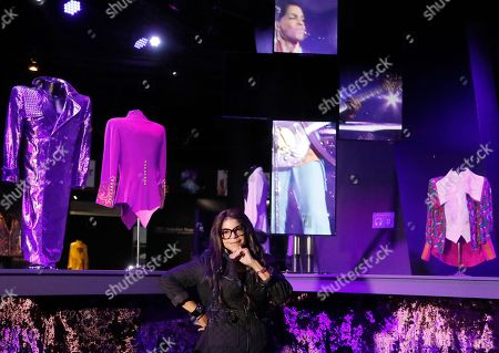 Musician Prince's sister Tyka Nelson poses for photographers in front of 'Purple Rain' era costumes at the 'My Name is Prince' exhibition at the O2 Arena in London, . The exhibition showcases hundreds of never before seen artefacts direct from Paisley Park, Prince's famous Minnesota private estate. Visitors will get a unique insight into the life, creativity and vision of one of the most naturally gifted recording artists of all time from October 27, 2017 until January 7, 2018