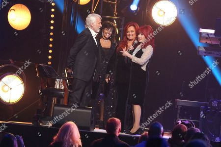 "Kenny Rogers, Wanda Miller, Wynonna Judd, Naomi Judd. From left, artist Kenny Rogers with wife Wanda Miller share stories onstage with artists Wynonna Judd and Naomi Judd at ""All In For The Gambler: Kenny Rogers' Farewell Concert Celebration"" at Bridgestone Arena on in Nashville, Tenn"