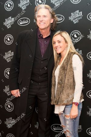 "Stock Photo of Billy Dean, Chloe Channell. From left, artists Billy Dean and Chloe Channell on the red carpet of ""All In For The Gambler: Kenny Rogers' Farewell Concert Celebration"" at Bridgestone Arena on in Nashville, Tenn"