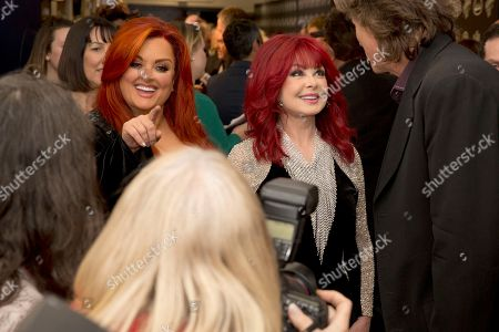 "Wynonna Judd, Naomi Judd. From left, artists Wynonna Judd and Naomi Judd backstage at ""All In For The Gambler: Kenny Rogers' Farewell Concert Celebration"" at Bridgestone Arena on in Nashville, Tenn"
