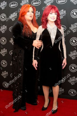 "Wynonna Judd, Naomi Judd. From left, artists Wynonna Judd and Naomi Judd on the red carpet of ""All In For The Gambler: Kenny Rogers' Farewell Concert Celebration"" at Bridgestone Arena on in Nashville, Tenn"