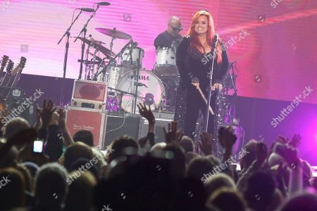 "Artist Wynonna Judd performs at ""All In For The Gambler: Kenny Rogers' Farewell Concert Celebration"" at Bridgestone Arena on in Nashville, Tenn"