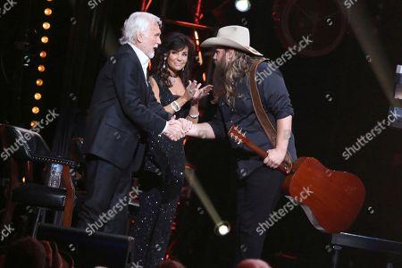 """Kenny Rogers, Chris Stapleton. From left, artist Kenny Rogers greets artist Chris Stapleton at """"All In For The Gambler: Kenny Rogers' Farewell Concert Celebration"""" at Bridgestone Arena on in Nashville, Tenn"""