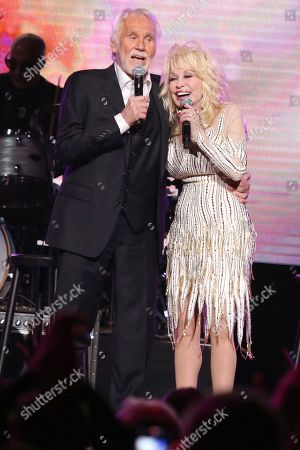 "Kenny Rogers, Dolly Parton. From left, artists Kenny Rogers and Dolly Parton perform at ""All In For The Gambler: Kenny Rogers' Farewell Concert Celebration"" at Bridgestone Arena on in Nashville, Tenn"