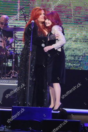"Wynonna Judd, Naomi Judd. From left, artists Wynonna Judd and Naomi Judd perform at ""All In For The Gambler: Kenny Rogers' Farewell Concert Celebration"" at Bridgestone Arena on in Nashville, Tenn"