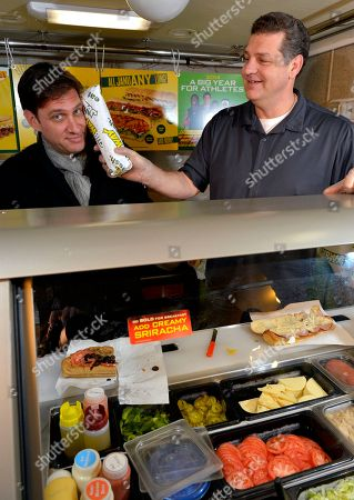 ESPN's Mike Greenberg, left, and Mike Golic joke around behind the SUBWAY sandwich counter in the SUBWAY Fresh Take Green Room, in New York