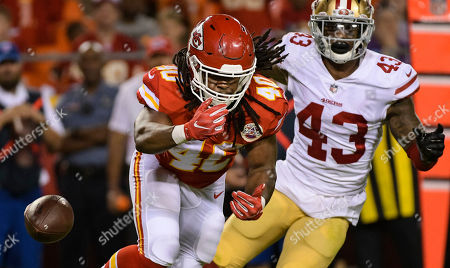 Stock Image of Devine Redding, Chanceller James. Kansas City Chiefs running back Devine Redding (40) can't make this catch in front of San Francisco 49ers safety Chanceller James (43) during an NFL preseason football game in Kansas City, Mo