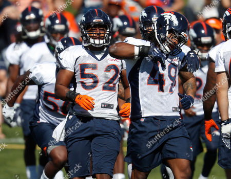 Denver Broncos inside linebacker Corey Nelson (52) and Denver Broncos linebacker Quentin Gause (49) take part in drills during an NFL football training camp, in Englewood, Colo