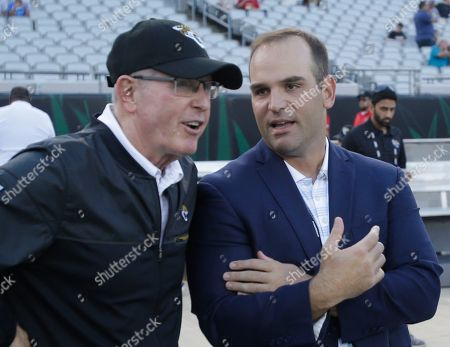 Jacksonville Jaguars executive vice president of football operations Tom Coughlin, left, talks with team general manger David Caldwell before an NFL preseason football game against the Tampa Bay Buccaneers, in Jacksonville, Fla