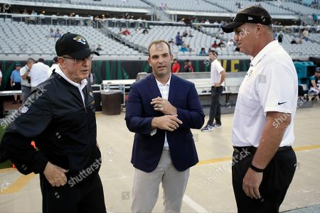 Jacksonville Jaguars executive vice president of football operations Tom Coughlin, left, talks with team general manger David Caldwell, center, and head coach Doug Marrone before an NFL preseason football game against the Tampa Bay Buccaneers, in Jacksonville, Fla