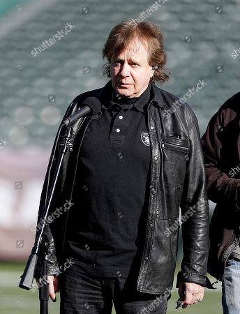 Singer Eddie Money practices singing the national anthem before an NFL football game between the Oakland Raiders and the Indianapolis Colts in Oakland, Calif