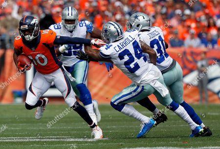 Denver Broncos wide receiver Emmanuel Sanders (10) runs as Dallas Cowboys cornerback Nolan Carroll (24) and free safety Byron Jones (31) defend during the first half of an NFL football game, in Denver