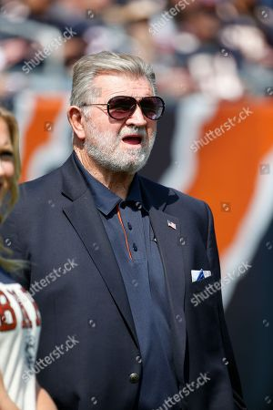 Former Chicago Bears head coach Mike Ditka watches from the sideline during the first half of an NFL football game between the Chicago Bears and the Atlanta Falcons, in Chicago