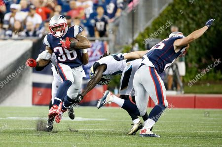 Stock Picture of New England Patriots tight end Sam Cotton, right, puts a hit on a Jacksonville Jaguars player as New England Patriots running back Brandon Bolden (38) rushes with the ball during an NFL preseason football game, in Foxborough, Mass