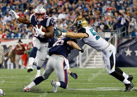 Stock Picture of LeShun Daniels, Sam Cotton. New England Patriots running back LeShun Daniels (39) runs around a block by tight end Sam Cotton (85) in the second half of an NFL preseason football game against the Jacksonville Jaguars, in Foxborough, Mass